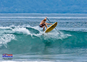 Robby Naish stand up paddle Costa Rica,  landing after some air